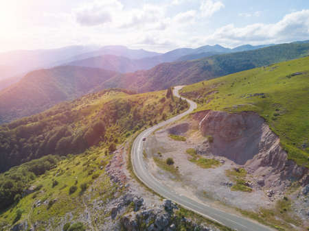 Top view of car on curvy mountain road with beautiful view Banco de Imagens
