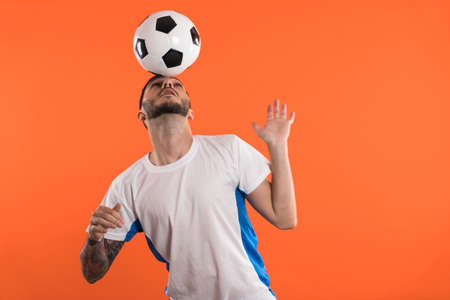 Football fan or player doing Headers isolated Banco de Imagens