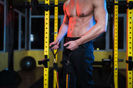 Strong man doing reps of workout using Resistance band