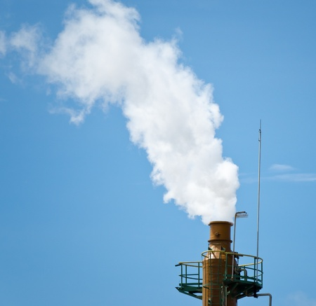 Exhaust stack releases steam into sky