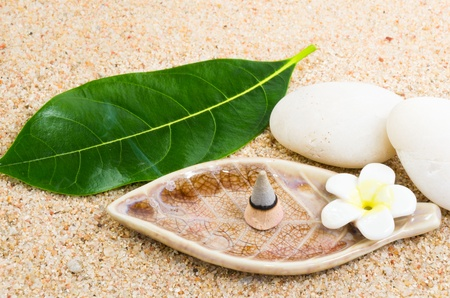 Burning incense cone on sand spa Stock Photo