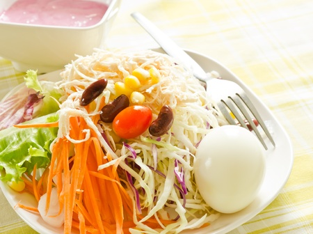 Fresh salad with egg,carrot,red beans and cherry tomatoes