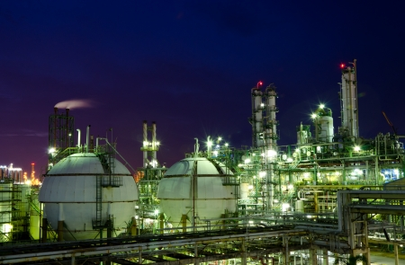 Gas storage spheres tank in petrochemical plant at night photo