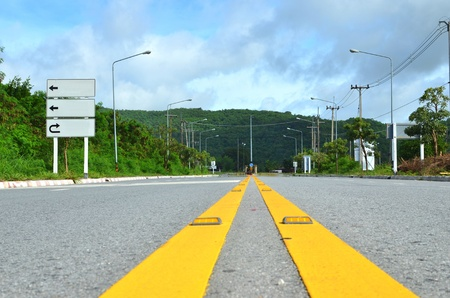 yellow line: Yellow line on road to moutain with traffic sign