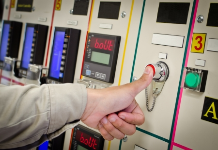 Hand pushing on control panel Stock Photo