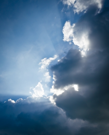 Sun rays through the clouds photo