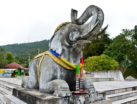 Old white elephant statue at north Thailand photo
