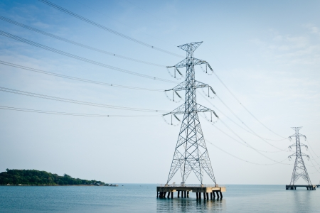 High voltage power pole in the sea photo
