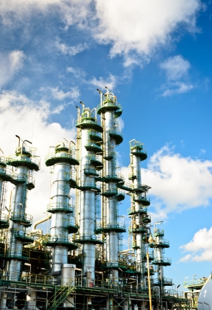 column tower in petrochemical plant and blue sky Stock Photo