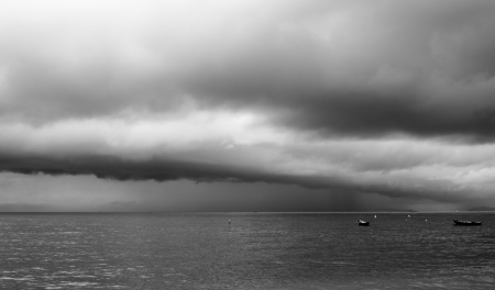 Huge storm clouds with rain over fishing boat