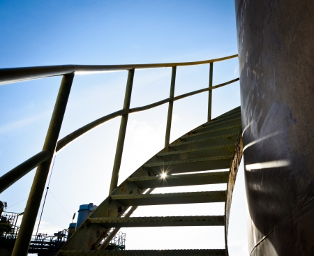 steel spiral up stairs on storage tank photo