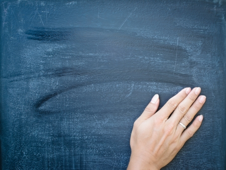 Erasing the chalkboard by hand photo