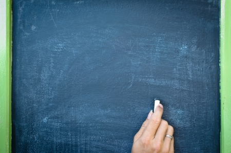 Writing with chalk on black board