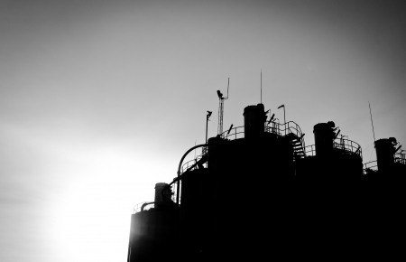 silhouette tops of industrial silos