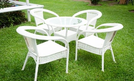 relax backyard with white table and chairs Stock Photo