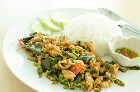 Thai food rice and chicken curry with basil leaves photo