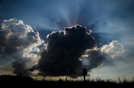 Sun rays through the black clouds Stock Photo - 17223847