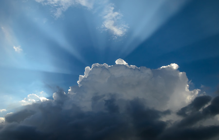 Black and White Clouds with Sunray photo