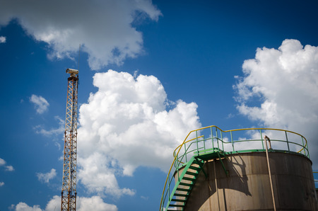 camera security on column with storage  tank and blue sky background Stock Photo