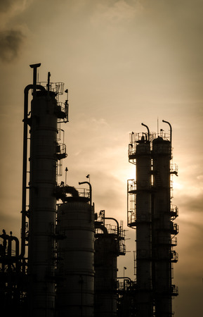 silhouette of silent column tower in petrochemical plant  vintage style Stock Photo