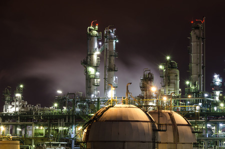 oil industry: petrochemical plant column tower and sphere tank gas at night