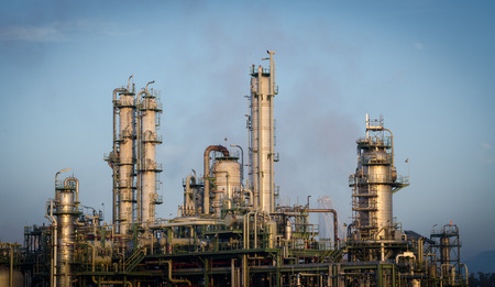 globalwarming: column tower and petrochemical plant industrial at morning time Stock Photo
