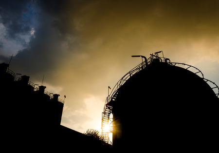 petrochemical: petrochemical plant in silhouette at sunrise