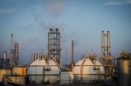 Gas storage tanks and petrochemical  plant at morning time Stock Photo