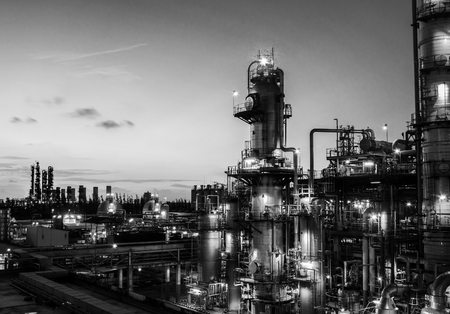 black and white plant: black and white column tower in petrochemical plant at dawn