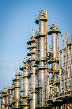 oil industry: column tower in petrochemical plant and blue sky back ground Stock Photo