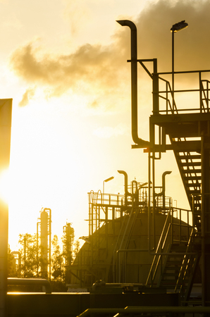 Silhouette of petrochemical plant in sunrise