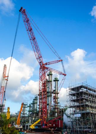 petrochemical plant: petrochemical plant under construction,crane working Stock Photo