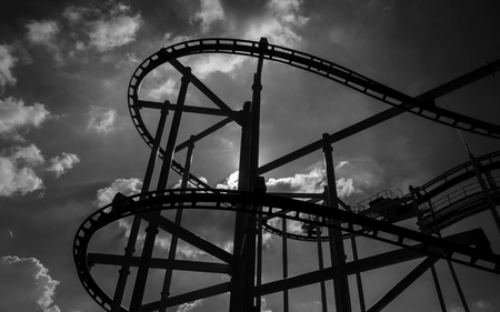 amusement park black and white: black and white rollercoaster track in funny amusement park.