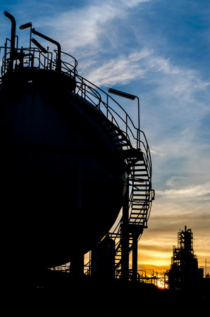 silhouette of sphere gas storage tank in morning time Stock Photo