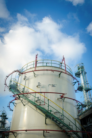 tank: Storage tank in industrial plant and blue sky background Stock Photo