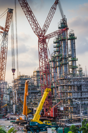 construction plant: petrochemical plant under construction,crane working Stock Photo