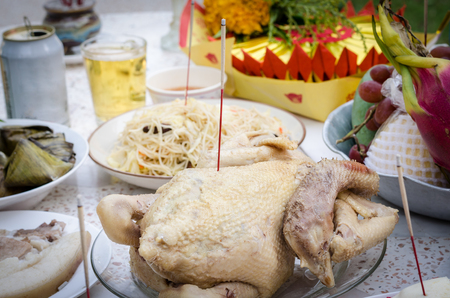 Boiled chicken with incense stick for Sacrificial offering Chinese Culture