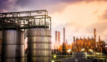 storage tank with petrochemical plant background