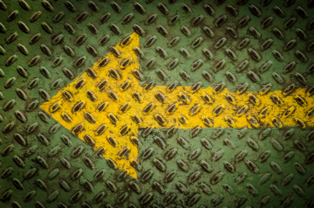 steel plate with yellow arrow background