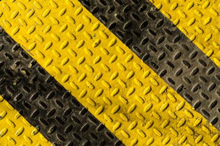 grunge black and yellow iron surface background Stock Photo