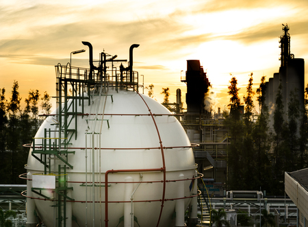 sphere gas storages in petrochemical plant at dawn
