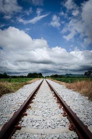 Railroad  blue sky and cloudy rain