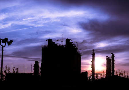 silo and column tower petrochemical plant at twilight