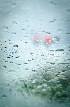 heavy rain drops on front car glass