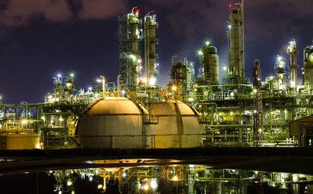 reflex gas storage spheres tank in petrochemical plant at night Stock Photo