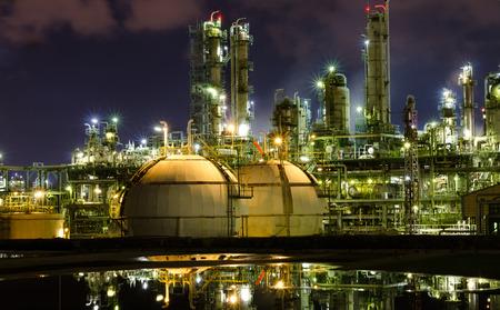 petrochemical plant: reflex gas storage spheres tank in petrochemical plant at night Stock Photo