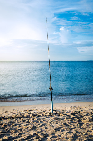 fishing rod on the beach at morning.