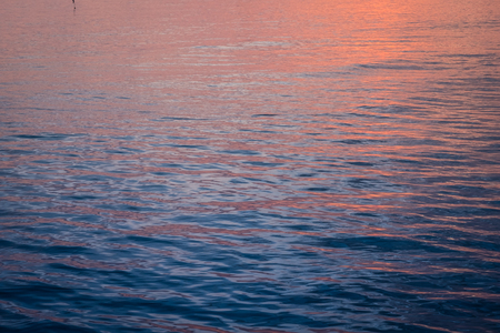 ripple wave: beauty colorful of wave surface when sun rise,abstract series of waves on the water surface ripple background