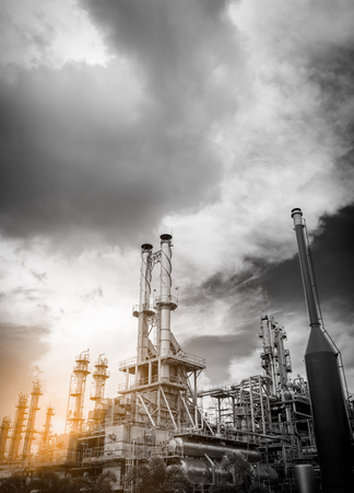 petrochemical plant (black & white image) with rain clouds Stock Photo