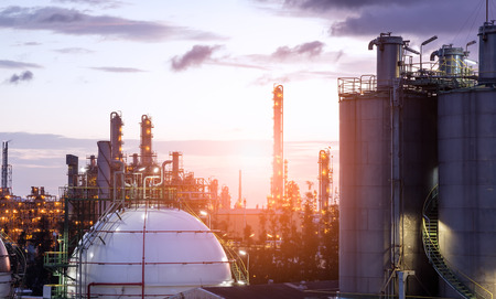 Gas storage spheres tank in oil refinery plant on sky sunrise background Stock Photo